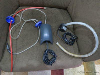 Слева система с двумя бутылками. справа помпочка наверное для фонтанчиков, сагем кажись, просто опускается в 20литровое ведро, а трубка в акву. - 3.JPG